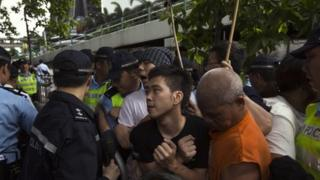Pro-democracy protesters clashing with police in Hong Kong on 1 July 2013