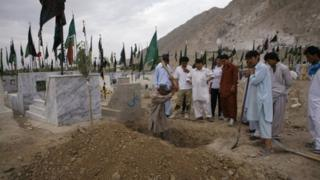 A man digs a grave for a victim of Sunday's bomb blast in Quetta July 1, 2013