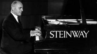 Solomon playing a Steinway