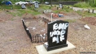 The vandalised gravestones