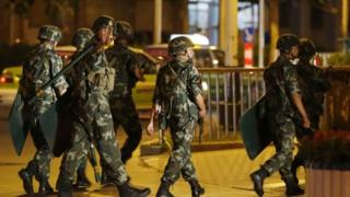 Beijing says paramilitary soldiers are deployed in Xiniang to end violence
