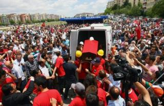 People carry the coffin of Ethem Sarisuluk in Ankara, 16 June