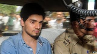 Indian actor Suraj Pancholi, boyfriend of the late Bollywood film actress Jiah Khan, sits inside a police vehicle on his way to a court in Mumbai on June 11, 2013