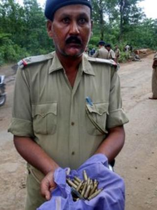 A policeman shows ammunition used in the Maoist attack