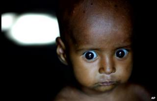 9-month-old Salma stares blankly from the doorway of her home on the Yamuna River in New Delhi Friday Aug. 17, 2001.