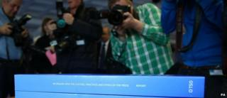 Photographers on the day the Leveson report was published