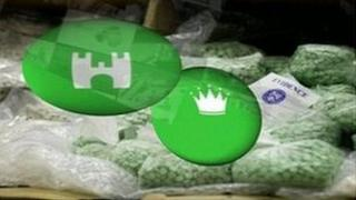 Artist's impression of the green-coloured tablets with crown and castle logos