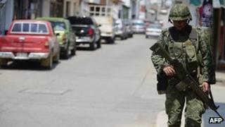 A Mexican soldier on a street in Coalcoman, Michoacan State, Mexico on 22 May 2013