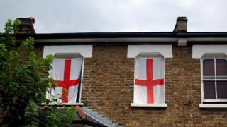 St George flags hanging in a window