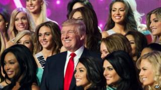 Donald Trump poses for a photo with the competitors during rehearsal for the Miss USA competition in Las Vegas on 15 June 2013