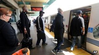 Passengers board a Bart train at West Oakland on Friday 5 July 2013