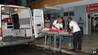 Ambulance workers take a woman injured in the bus crash, into the hospital in Cienfuegos, Cuba