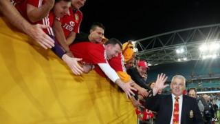 Warren Gatland takes the congratulations of Lions fans after the deciding Test in Sydney