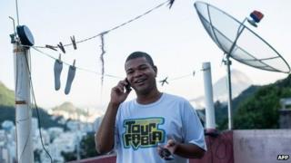 Brazilian on the phone in Rio favela