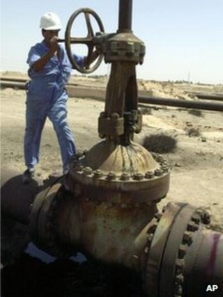Oil worker near pipeline in Basra, Iraq, in 2004