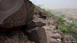 Ancient rock etchings, or petroglyphs, are seen in Narigua in the hills of southern Coahuila, file image