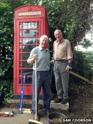 David Berridge and Brian Taylor outside the phone box in Ufford