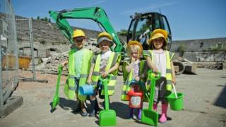Children from St Michael's Church Pre-school and Nursery donned hard hats and hi-vis jackets to watch work begin at The Barns