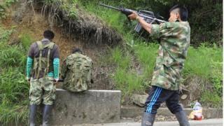 Farc member fires gun (4 June 2013)