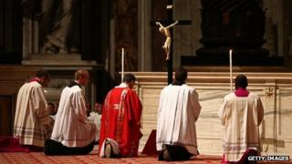 Bishops and priests pray under a crucifix (29 March 2013)