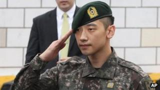 South Korean actor and singer Rain salutes to his fans and media in front of the Defense Ministry in Seoul, South Korea, 10 July 2103