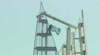 A protester unveiled a Greenpeace flag at the skyscraper's summit
