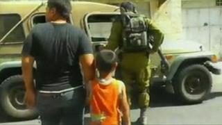 Wadi Maswadeh being led to an Israeli army jeep