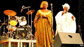Malian singer Bako Dagnon, right, performs during a concert at the Modibo Keita stadium in Bamako in June 2012