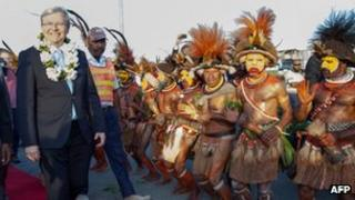 Australian Prime Minister Kevin Rudd (left) arrives in Port Moresby on 14 July 2013