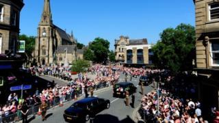 Crowds gather outside Bury Parish Church