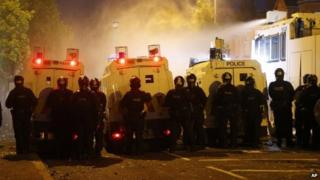 Riot police deploy a water cannon after being attacked by loyalist protesters in north Belfast.