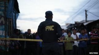 Police officer in Gutemala City, 26 June 13