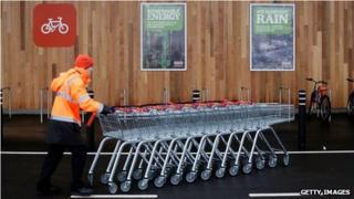 Sainsbury's employee pushes trolleys in King's Lynn