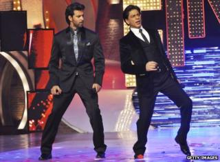 Bollywood actors Shah Rukh Khan, right, and Hrithik Roshan perform on the finale of Indian reality show Just Dance in 2011.