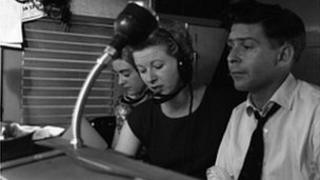 Barbara Chambers, Mary Evans and Ray Butt at the controls in the BBC Mobile Control Van outside the Stage Door of the Whitehall Theatre, 1960.
