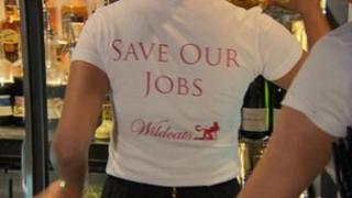 Bartender wearing 'save our jobs' t-shirt