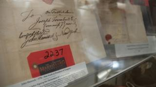 Signed letter by John Hancock just after signing the Declaration of Independence, with George Washington's signature in the background
