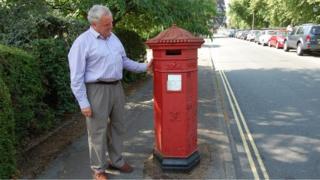 Penfold pillar box in College Lawn in Cheltenham