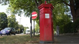 Penfold pillar box in Westall Green near corner of Queen's Road and Lansdown Road in Cheltenham