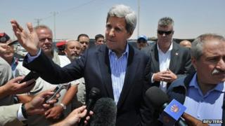 Secretary of State John Kerry speaks to reporters as Jordanian Foreign Minister Nasser Judeh (R) looks on during a visit to Zaatari refugee camp, near the Jordanian city of Mafraq July 18, 2013