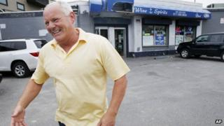 Stephen Rakes smiles after greeting an acquaintance outside the liquor store he once owned in the South Boston neighbourhood of Boston 6 June 2013