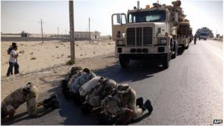 Egyptian soldiers pray as they are deployed in the northern Sinai town of El Arish on Tuesday