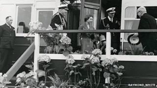 Queen Elizabeth II exits train