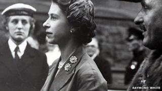 Queen Elizabeth II inspects sailors