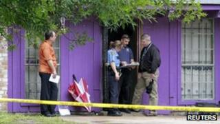 Police investigate a home where it was reported that four elderly men were held against their will in Houston on 19 July 2013