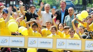 Yorkshire professional cyclist Dean Downing, Councillor Keith Wakefield, Welcome to Yorkshire chief Gary Verity and former cyclist Brian Robinson gather with local school children on the start line on the Headrow in Leeds marking one year to go until the start of the Tour De France 2014