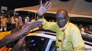 Jack Warner waves to supporters