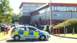 Police cordon at industrial unit