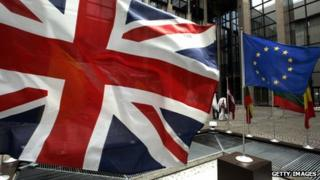 The Union Jack and the flag of the European Union fly side by side in EU's headquarters in Brussels