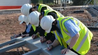 Schoolchildren signed steel frame